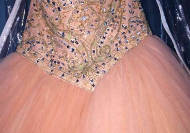 Sparkly peach quinceanera dress